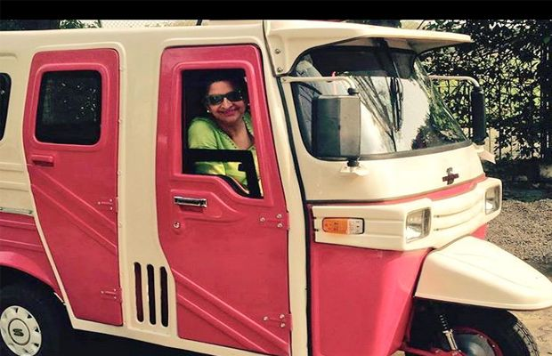 A lady takes a ride in one of the autos