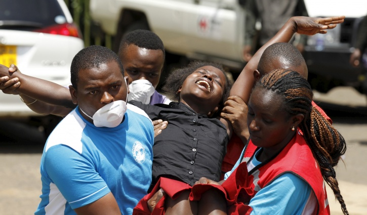 Red Cross Workers Carry An Injured Student