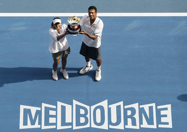 Sania with Bhupathi after Australian Open title