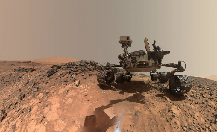 A low-angle self portrait was taken by NASA's Curiosity Mars rover before it started drilling into a target rock known as 'The Buckskin' on lower Mount Sharp. This particular selfie is special for two reasons; one, it is from a place where no self-obsessed selfie star has ever been, Mars. Two, it's more than just a duck face. The selfie combines several component images taken by Curiosity's Mars Hand Lens Imager (MAHLI) on Aug. 5, 2015, during the 1,065th Martian day, or sol, of the rover's work on Mars. For scale, the rover's wheels are 20 inches (50 centimeters) in diameter and about 16 inches (40 centimeters) wide.  <Image1> The selfie does not include the rover's robotic arm beyond a portion of the upper arm held nearly vertical from the shoulder joint. With the wrist motions and turret rotations used in pointing the camera for the component images, the arm was positioned out of the shot in the frames or portions of frames used in this mosaic, basically like how our Saturday night selfies in hotel washrooms, just that this one is from bloody Mars! <Image2> MAHLI is mounted at the end of the rover's robotic arm. For this self-portrait, the rover team positioned the camera lower in relation to the rover body than for any previous full self-portrait of Curiosity.  <Image3> Curiosity's landed inside Mars' Gale Crater on August 2012.