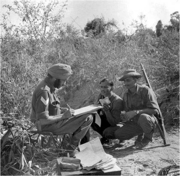Indian soldiers receiving pay