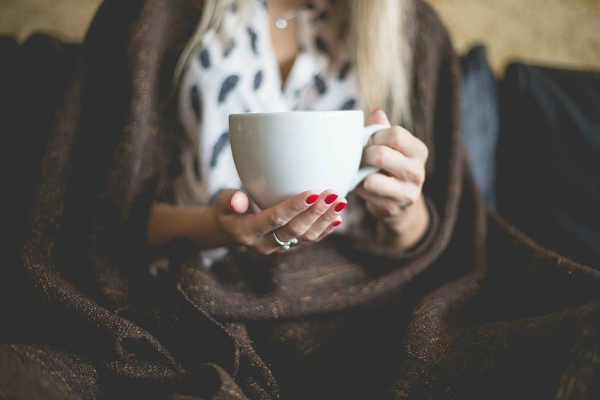 coffee and red nail paint