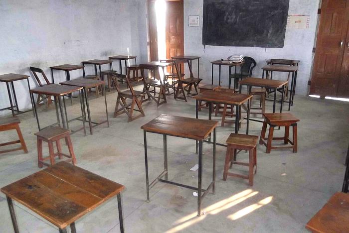 headmaster + principal date in an empty classroom