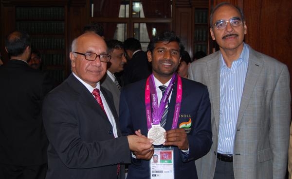HN Girisha with his 2012 Paralympics silver medal