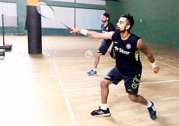 Kohli Bhajji playing badminton