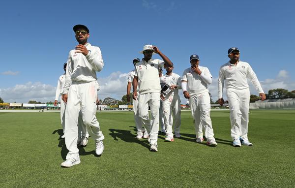 Kohli leads the team out