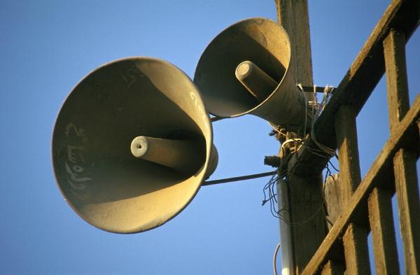 blaring loudspeakers