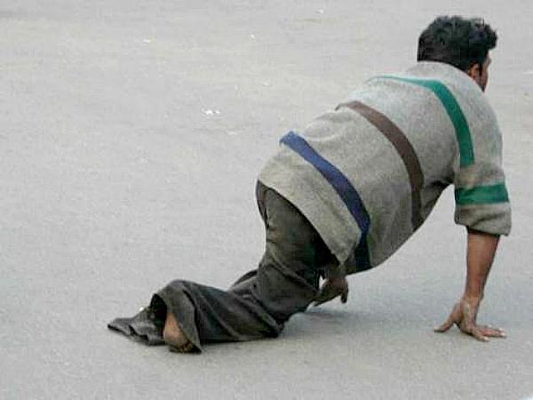 beggar crawling