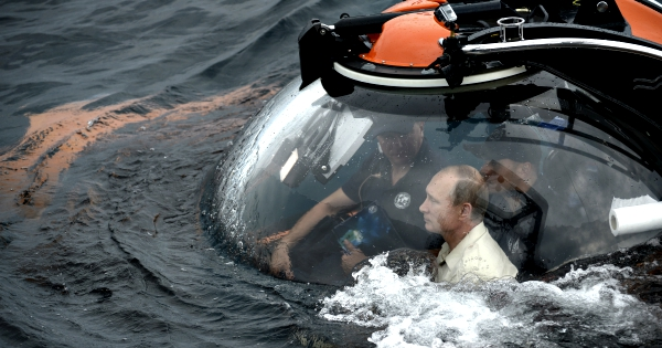 Russian President Vladimir Putin has burnished his action man image by diving down in a mini-submarine