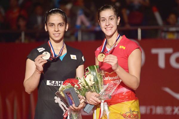 Saina Nehwal with gold medallist Carolina Marin