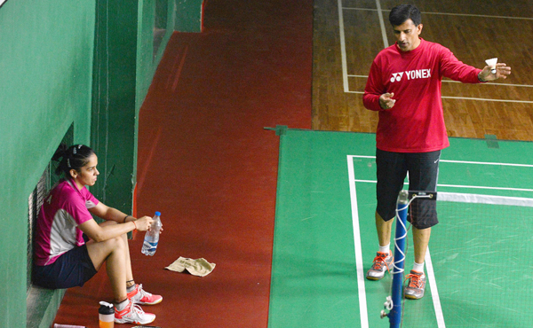 Saina with coach Vimal Kumar