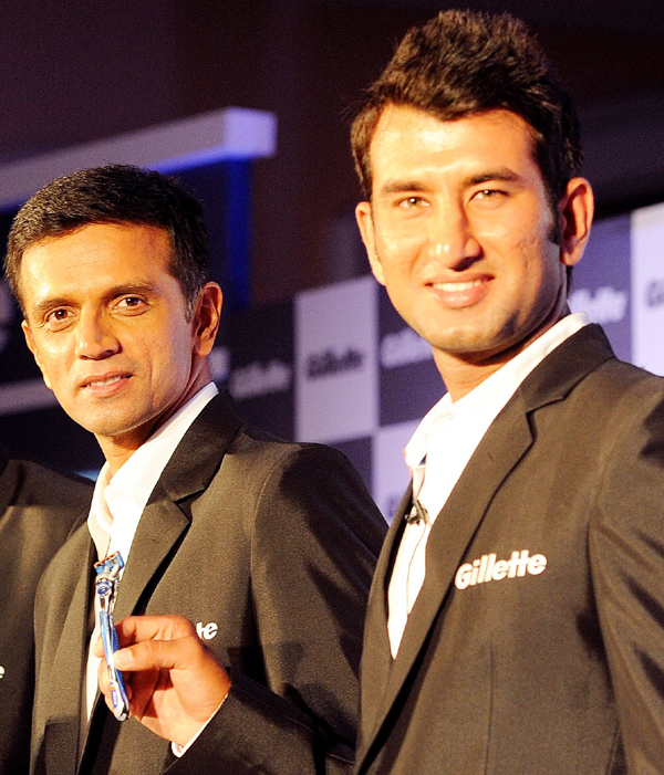 Dravid and Pujara at a promotional event
