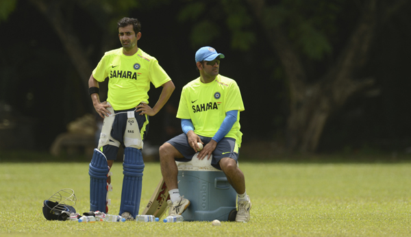 Gambhir and Dhoni during a practice session in 2012