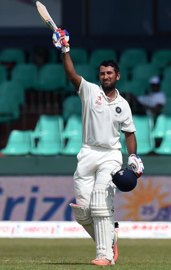 Pujara celebrates his ton against Sri Lanka