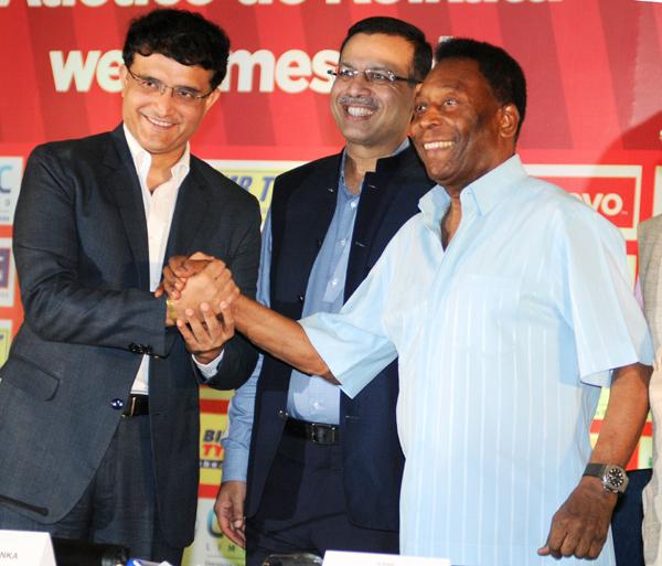 Sanjiv Goenka with Sourav Ganguly (left) and football great Pele (right)