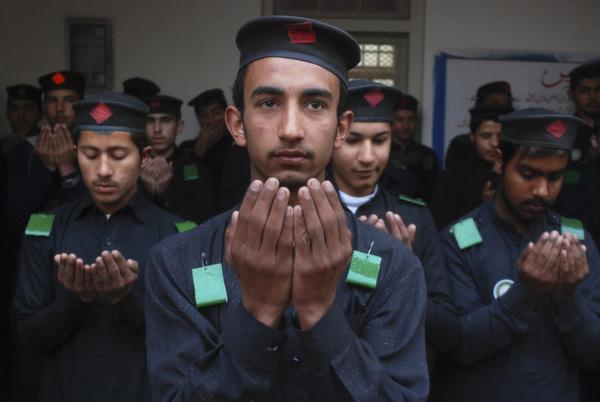 students praying peshawar