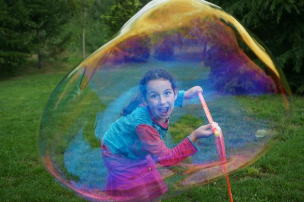 girl playing with a bubble