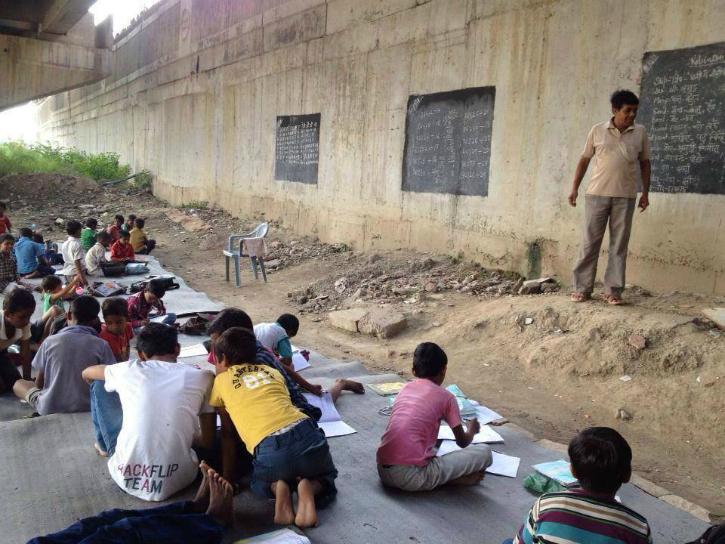 Free school under the bridge in Delhi