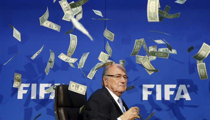 A British comedian rained fake dollar notes on Sepp Blatter.