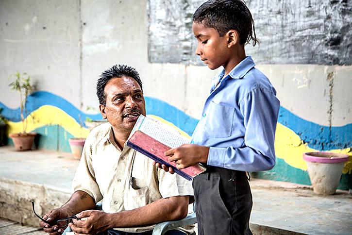 Rajesh Kumar Sharma teaches slum kids for free