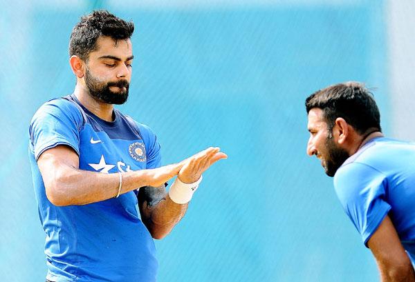 Kohli with Pujara