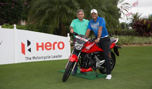 Pawan Munjal with Tiger Woods