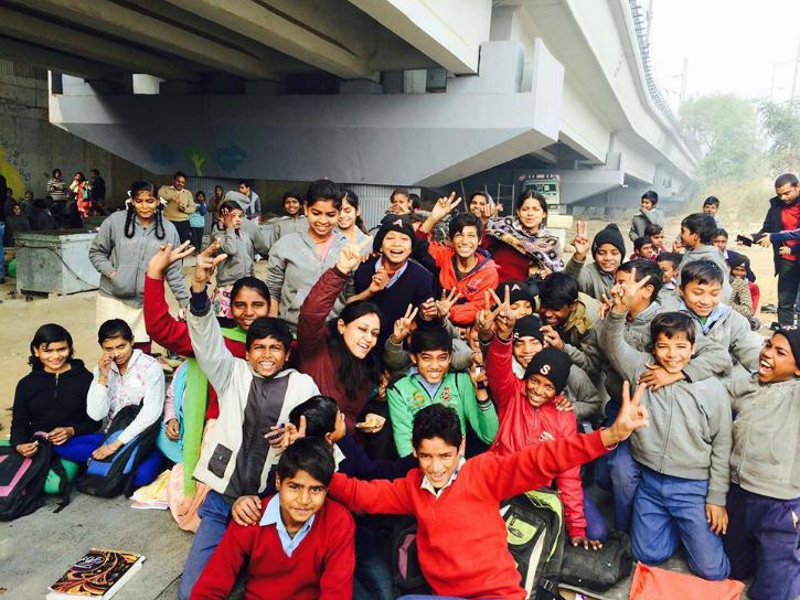 hundreds of kids study at Free school under the bridge in Delhi