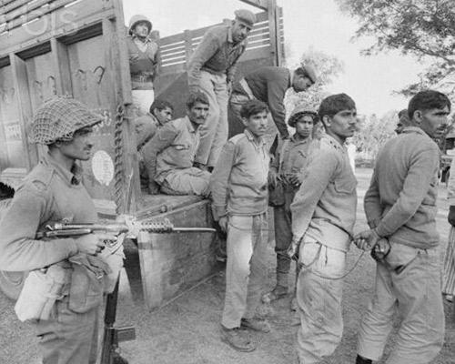 Indian Soldier supervises unloading