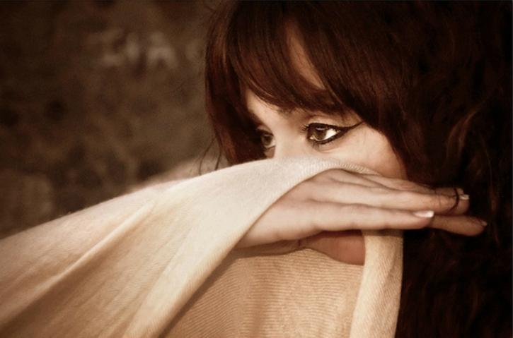 women hiding her face