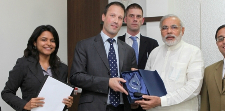 APCO Worldwide officials with Narendra Modi