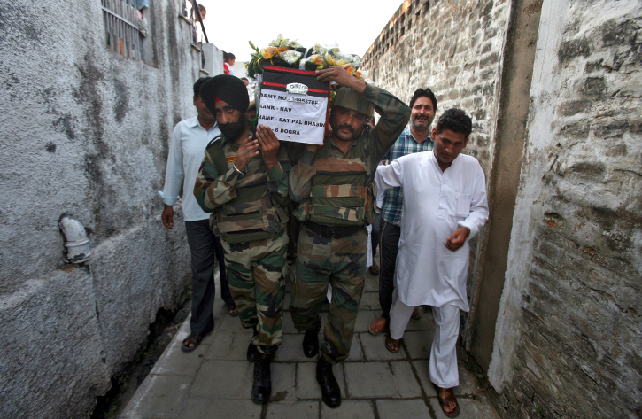 Army jawans carry collegue
