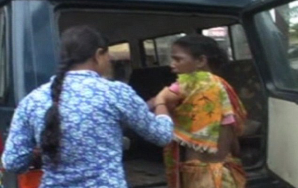 Pramila being taken in a police van