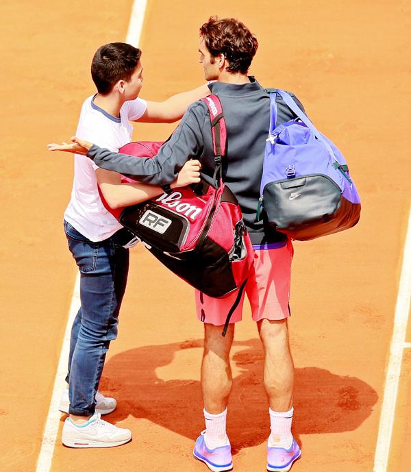 Roger Federer with a fan