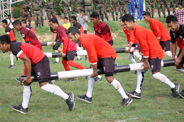 Indian footballers being trained by army officers