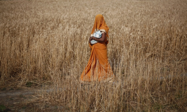 woman with child in a field