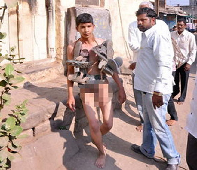 Teenager Paraded Naked