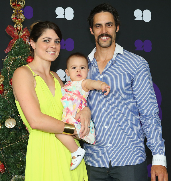 Mitchell Johnson with wife and daughter