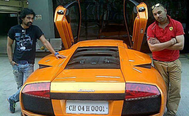Yuvraj with Ranvijay showing off his Lamborghini Gallardo
