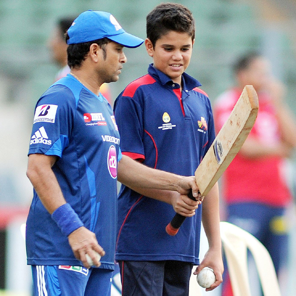 Arjun with daddy Sachin
