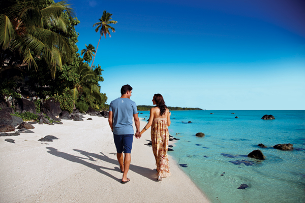 couple walking on a beach (for representation only)