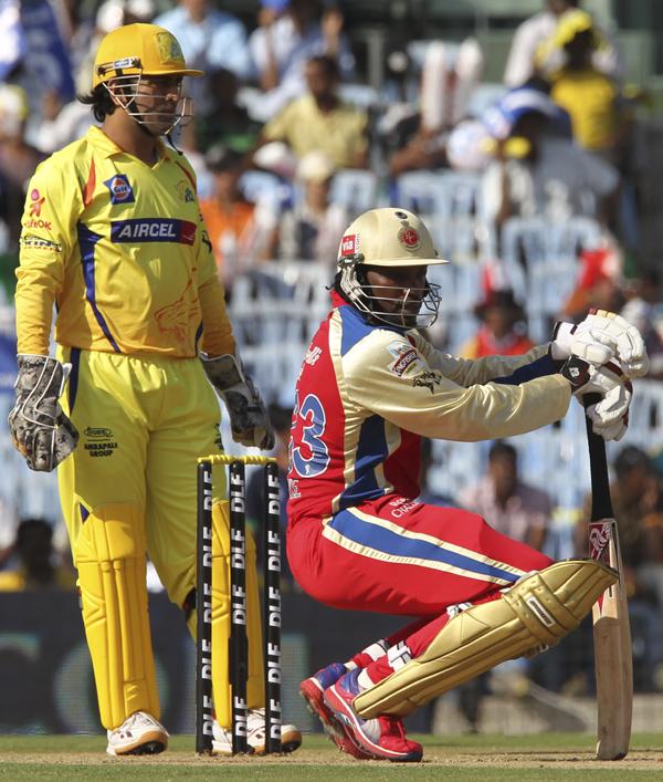 Dhoni keeps stumps behind the wicket as Gayle readies to bat