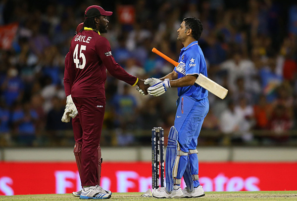 Dhoni and Gayle after the match