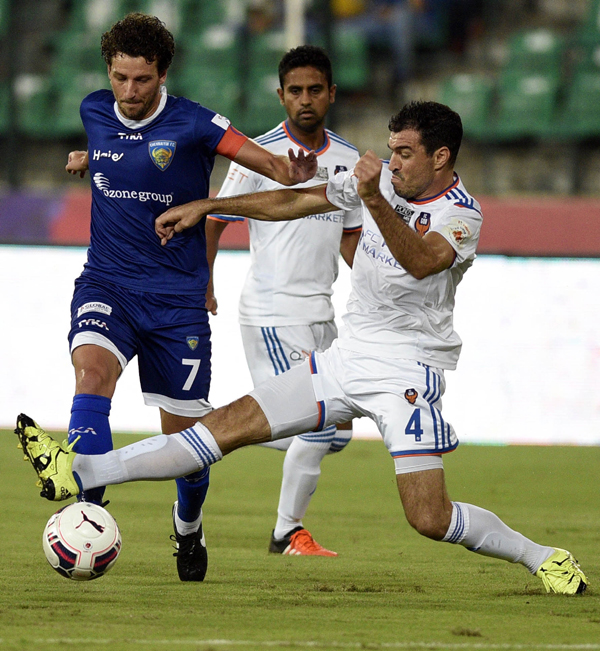 FC Goa players in action wearing white