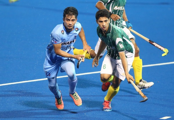 Players vying for the ball during Junior Asia Cup final