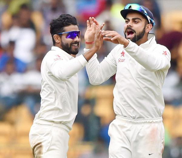 Kohli and Jadeja celebrate