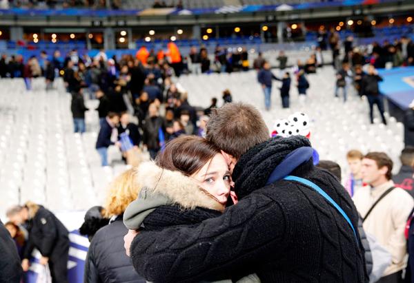 Spectators scampering inside Stade de France