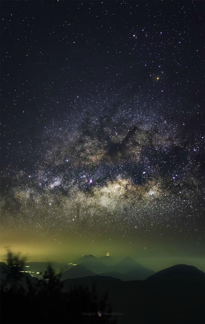 Erupting Volcano and Milky Way Galaxy