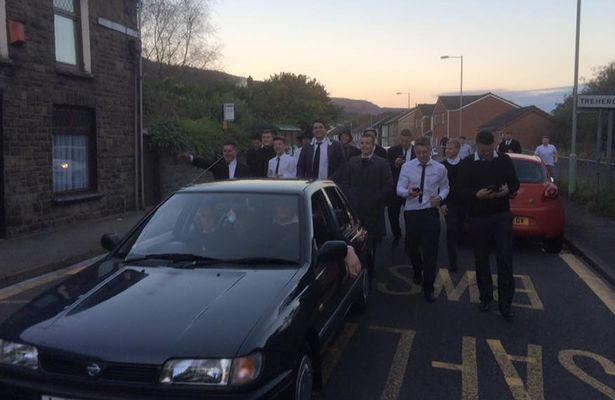 Mates who threw a mock-funeral for their friend