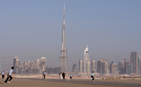 People playing cricket as Burj Khalifa can be seen in the background