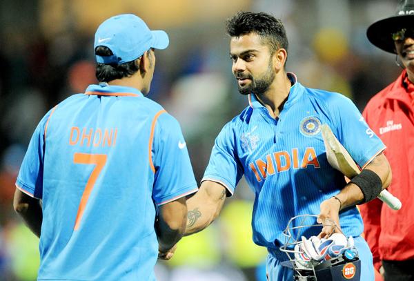 Dhoni and Kohli celebrate a win